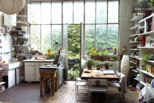 This Paris apartment offers a fantastic view through the floor to ceiling windows and a nice combo of kitchen and dining. Imagine the home parties you could have in this space!