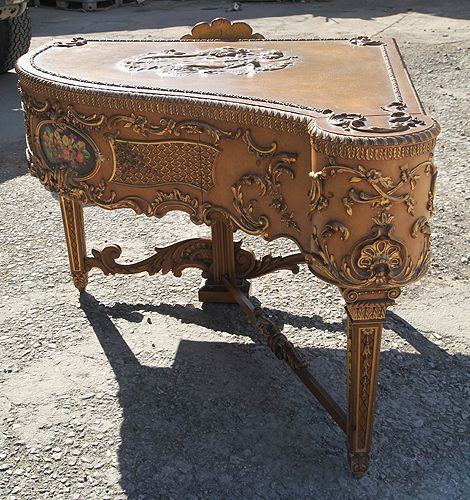 An extrememly rare, Claviano grand piano built for songwriter and film star Ivor Novello. This piano has an ornately carved, rococo style case with gilt accents. The piano spans five and a half octaves and has been strung using bi-chords at Besbrode Pianos