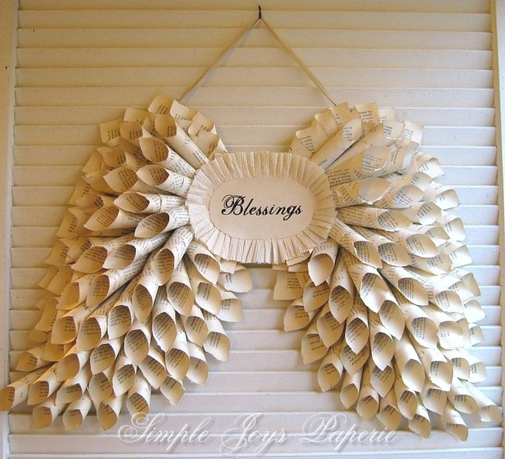 wings made of book pages if i ever have my own little shop this is surely going to grace the wall