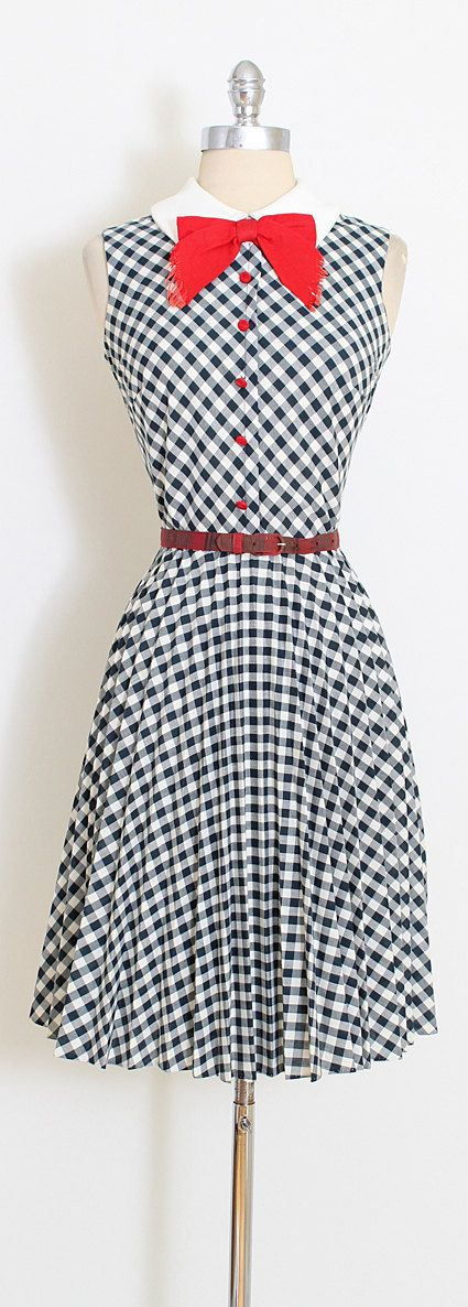 ➳ vintage 1960s dress  * black and white gingham print cotton * red buttons and bow * metal back zipper * pleated skirt * complimentary belt included  condition | excellent  fits like medium  length 40 bodice 17 bust 38 waist 28   ➳ shop http://www.etsy.com/shop/millstreetvintage?ref=si_shop  ➳ shop policies http://www.etsy.com/shop/millstreetvintage/policy  twitter | MillStVintage facebook | millstreetvintage instagram | millstreetvintage  5...