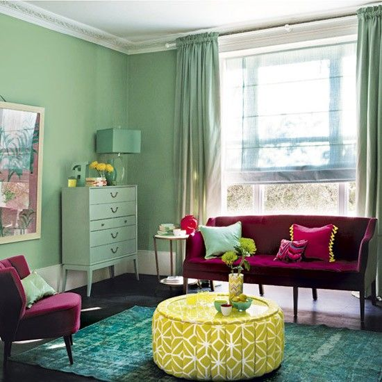 Pistachio and raspberry make a vibrant statement in this living room. Using the same shade on the walls and curtains simplifies the look, while the shots of pink and yellow highlight and lift the darker colours. Sofa William Yeoward Green paint Farrow & Ball Footstool fabric Turnell & Gigon