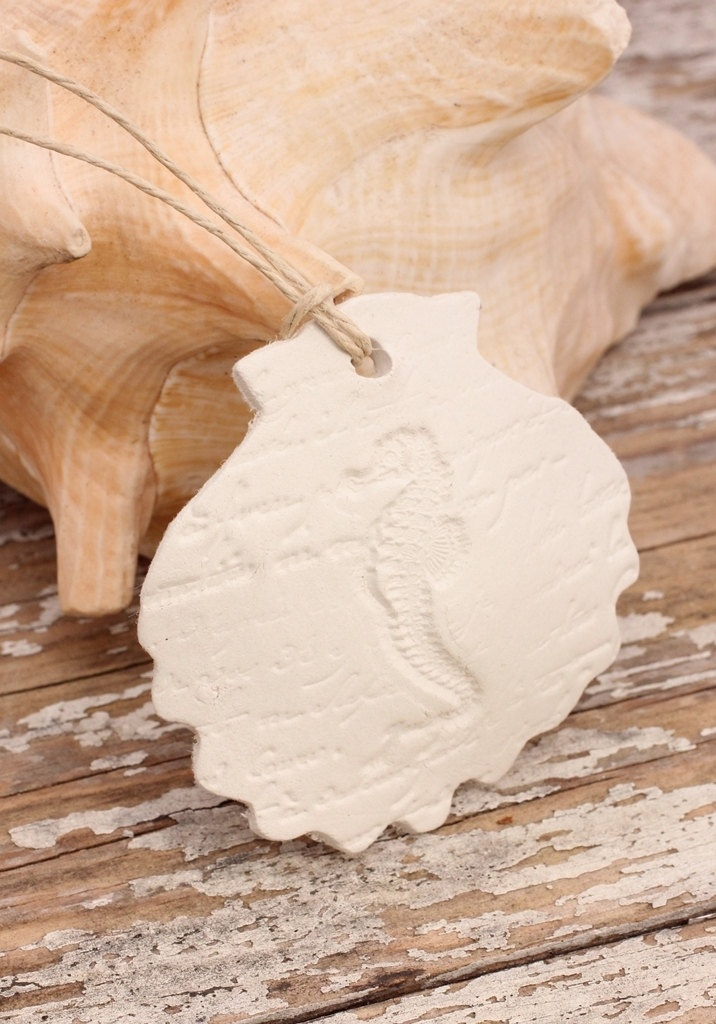 Shell and Seahorse Ornaments White Clay Seaside Christmas Ornaments Beach Wedding Favors: Hand Stamped Coastal Christmas Decor. $17.00, via Etsy.