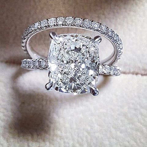 Beautiful cushion cut engagement ring paired with a pave wedding band…