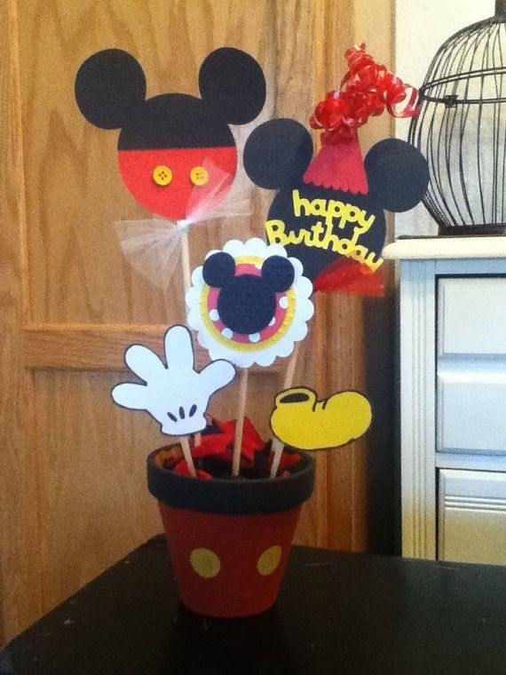 Mickey Mouse Birthday party centerpiece. Love the pot idea with foam circles to make mickey and spray painted black.