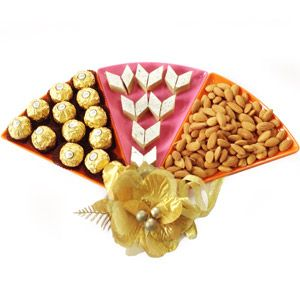 Raksha Bandhan 3 in 1 3 Milton microwave safe triangle platters comes with 200 grams of kaju katli, 200 grams of almonds and 16 pieces of Ferrero Rochers chocolates. Rs 2888/- http://www.tajonline.com/rakhi-gifts/product/r4570/raksha-bandhan-3-in-1/?aff=pint2014/