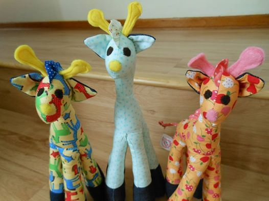 Giraffes made up in different fabrics.