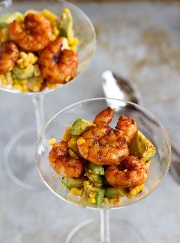 Delicious spiced shrimp served over a bed of avocado corn & A Few Squirts Of lime. Served beautifully in a martini glass. Love.