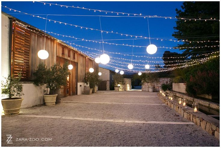 Light up and beautify your #outdoor areas of your #wedding with fairy lights, paper #lanterns and candles in vases.  #Lighting ideas like this created #ambiance and warmth and will convert an ordinary entrance to a night time wonderland.  See more of this wedding at #Rockhaven on the #ZaraZoo blog http://www.zara-zoo.com/blog/wedding-at-rockhaven/