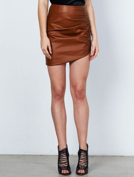 ISLA RESOURCE SKIRT from the Stardust Collection. For effortless style we've created this tobacco coloured faux-leather mini skirt this season. Crafted in asymmetric panels this versatile piece can be pared with boots and knits, or something a little sexier for the evening. Fully lined, with a concealed side zip. Available: www.islalabel.com #islalabel #fashion #style #winter #skirt #miniskirt #tobacco #leather #versatile