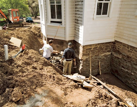 The original stone foundation was excavated, repointed, and waterproofed to keep the house dry from the bottom up. Downspouts lead to an underground drainage system that transports water runoff to a small wetlands garden sited away from the house.