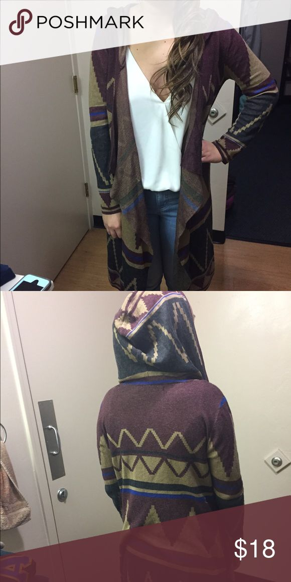 Foreign Exchange Tribal Print cardigan with hood Tribal print with burgundy, black, tan and a hint of blue. Long and very good winter or fall style paired with boots or booties. Has a hood as well. Moderately warm for weather in the 50s Foreign Exchange Sweaters Cardigans