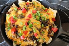 Cast iron skillet nacho supreme recipe. Yum!