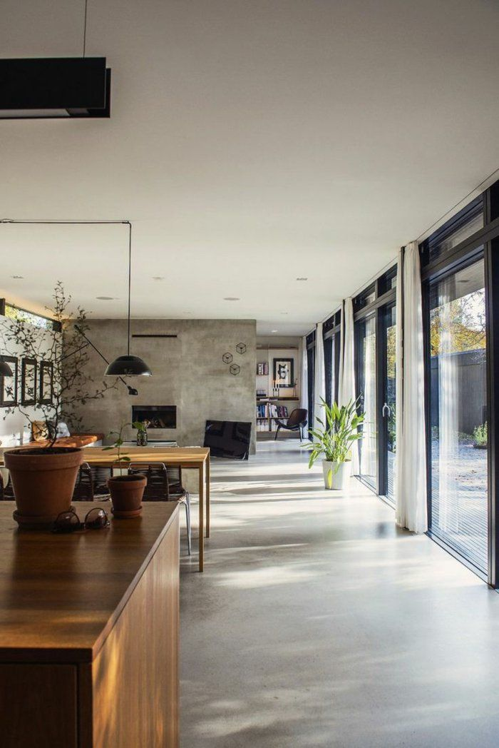 une jolie cuisine avec sol en béton ciré de couleur gris