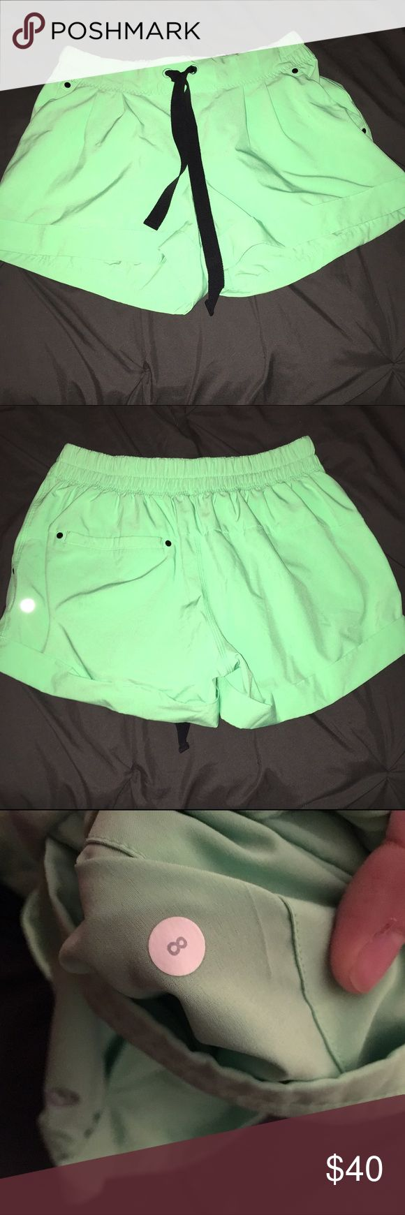 Neon Green Lululemon Shorts Neon Green Lululemon Shorts. GUC.  No damages, rips, or stains. Green shorts with black draw string waist. lululemon athletica Shorts