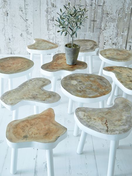 Small Tree Table. Each small table is carved from a tree trunk; preserving it's natural shape. This means that each table top is different.