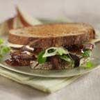Edelweiss Town Hall Emmentaler and Confit Duck Sandwiches - Pan-grilled sandwiches made with dried fig jam, shredded duck confit, emmentaler cheese and watercress. Recipe by Chef Michael Smith.