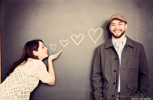 A Flying Kiss - 40 Best Engagement Photo Ideas - EverAfterGuide