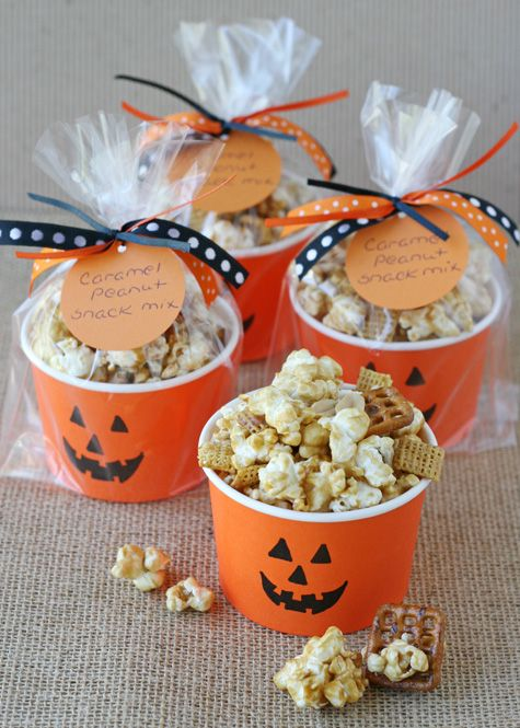 Caramel Corn Snack Mix: Caramel corn is a party staple, but mixed with pretzels, nuts and cereal, it really can't be beat. Serve it up in cute pumpkin cups for an extra spooky touch.This great Halloween party snack can work as party favor as well as snacks to fedd both kids and adults. Find more easy, quick and tasty DIY Halloween party snacks here.