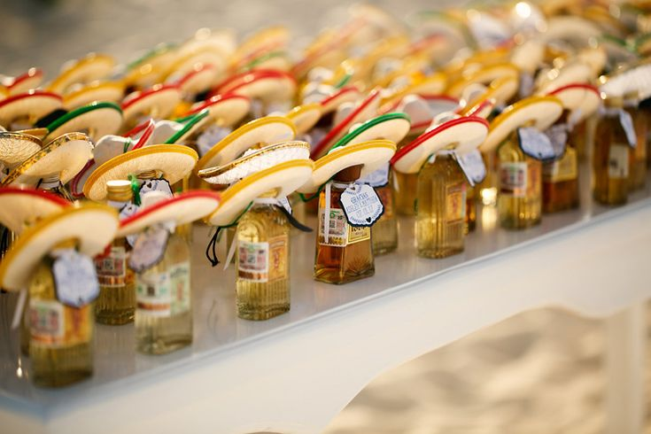 Adorable Mexico destination wedding idea: tequila shot favors with mini sombreros (Jonathan Cossu)