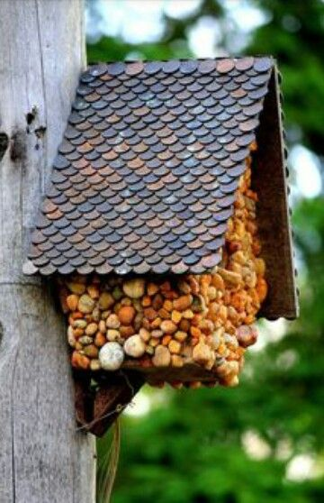 Bird Tree House, the roof is covered by one pence coins.