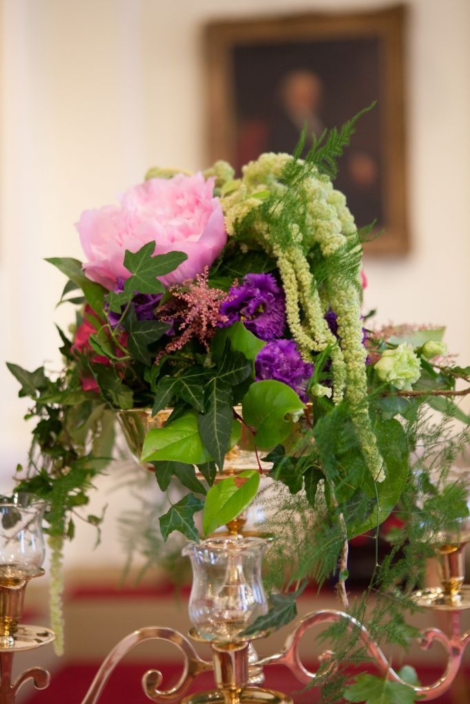Close up of tall flower arrangement featuring peony roses and hanging amaranthus at Number 6 KIldare St. Dublin