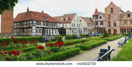 TANGERMUENDE, SAXONY-ANHALT/ GERMANY June 30 2013: Cityscape of Tangermunde (Saxony-Anhalt, Germany). typical half-timbered houses with rose garden