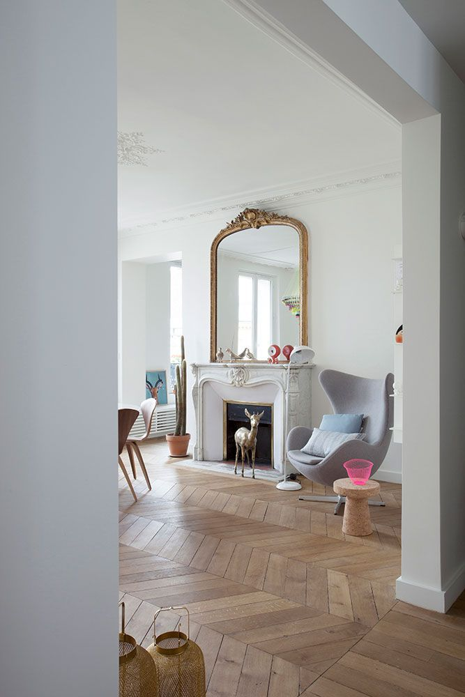 Typically Parisian interior, clean, white and uncluttered. Beautiful parquet floor