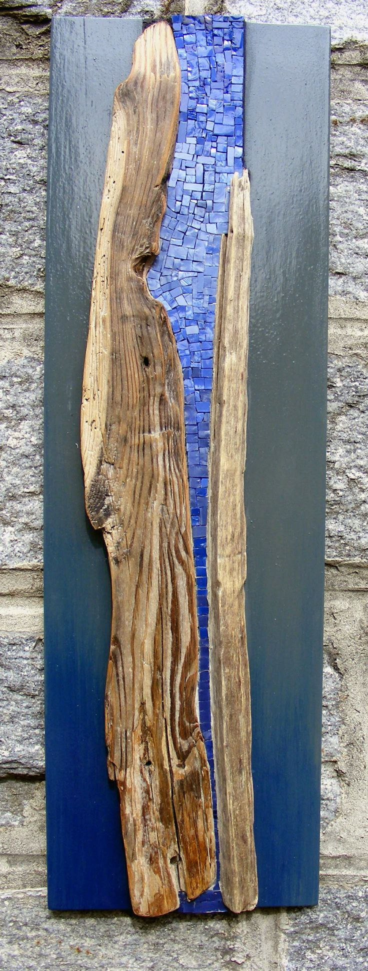 Mosaic in a drift wood from Brovelli Interior Design by Gagliela Pagliai.