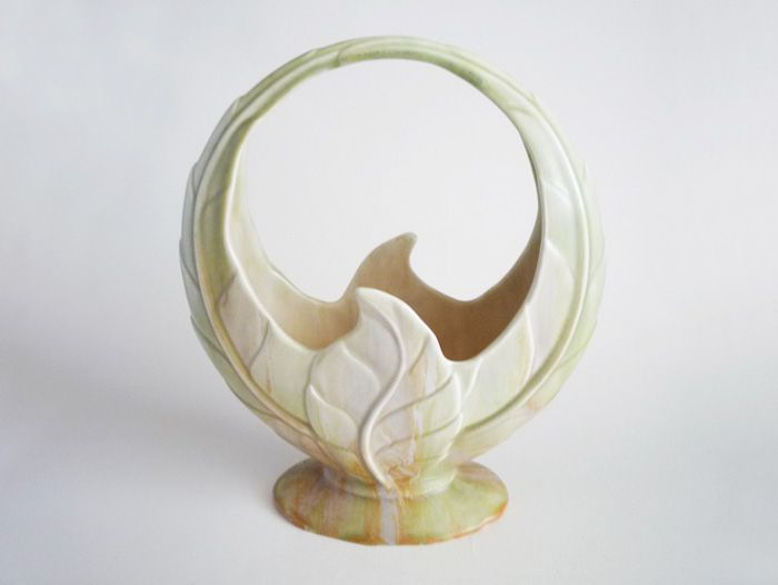 A large and impressive art deco vase designed by Mr Watkin and modelled as overlapping leaves forming a circular basket shape The satin matt glaze is