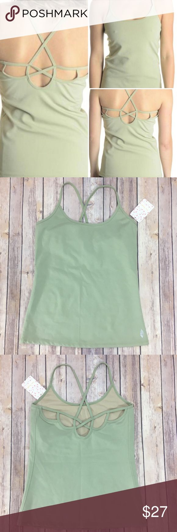 Free People Moonshadow Shelf Bra Camisole NWT Sz L Free People Moonshadow Shelf Bra Camisole NWT Sz L is a beautiful high performance tank top with a strapping back and built-in shelf bra.  From the Free People Activewear this gorgeous sage green cami is soft, stretchy and comfortable. Free People Tops