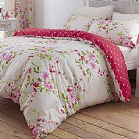 The timeless design combines garlands of pink roses on a cream background.         This double duvet cover set fits a standard double duvet and comes with two matching standard size pillowcases. PRICES FROM £18.99