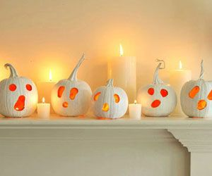 From familycircle.com  Little ghost-face lanterns lend a ghoulish glimmer to the mantel.    Here's how: Hollow out pumpkins (see tips below), then paint each one white, including stems. Use a grease pencil to draw three circles for the face, varying the shapes of the eyes and mouth on each to give the pumpkins personality. Carve out. Place a small votive inside pumpkins to illuminate.
