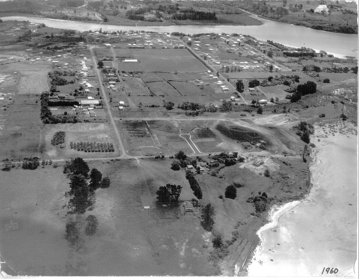 1960 Aerial view showing Henderson Creek and Lawson Creek at top of photo. Colwill Rd ends on the opposite side of the Creek from Wharf Rd, Te Atatu Peninsula (top left) Photo: Te Atatu Peninsula Business Association