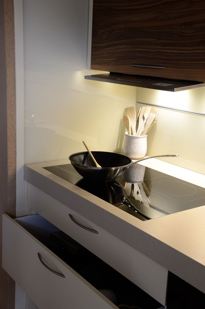 Kitchen furniture detail: Led lights and induction hob.