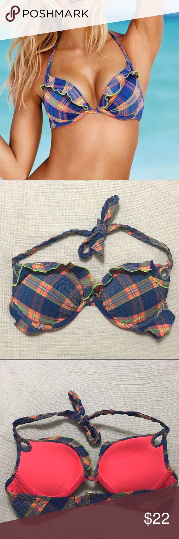 """Victoria's Secret Gorgeous Push-Up Bikini Top 34B Lightly-used Victoria's Secret Gorgeous Swim top. I loved it because it was used in the marketing that year. It's blue madras plaid with a ruffle along the top. Size is 34B. There is """"extreme"""" push up, and the thickest part of the push up padding is about an inch thick. Would look cute with a white, bright coral, or lime green bottom.  Price is never firm - make me an offer! Victoria's Secret Swim Bikinis"""