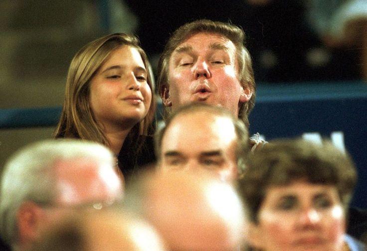 Donald Trump and his daughter Ivanka peek over
