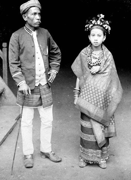 A couple from Lampung in traditional costume during colonial period.A couple??? that is really gross. He is OLD
