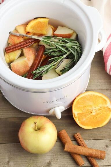 Using all natural ingredients, this homemade potpourri recipe allows you to simmer the smells of Fall all day long in a crock pot. This apple cinnamon potpourri recipe works just as well as a stovetop potpourri, too! Allowing fruits, herbs and plants to simmer in water at a high heat releases their natural fragrances. And those fragrances will waft through your home. During the Fall, it's so comforting to smell this delicious fragrance while you're curled up on the couch watchin…