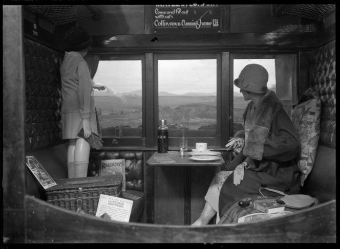 Interior of a railway carriage, showing several items of New Zealand Railways picnic equipmentc 1920's