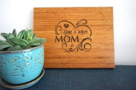 Home Is Where Mom Is The best Mothers Day gift item for your Mom. Spice up her kitchen with this personalized cutting board and she will