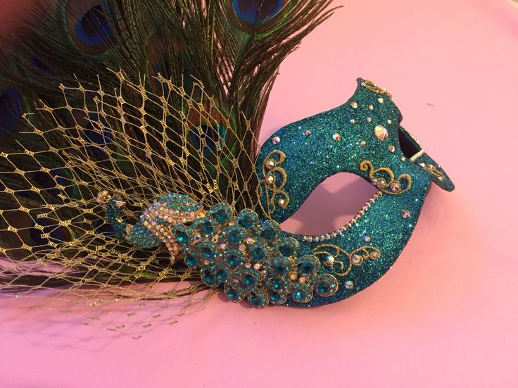 Feather peacock mask in turquoise blue and gold with Swarovski crystals