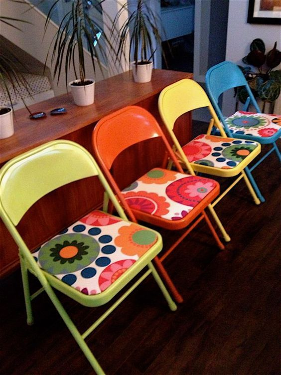 These chairs would be awesome if you used long tables!  Old metal folding chairs made new again.  Spray paint and new fabric