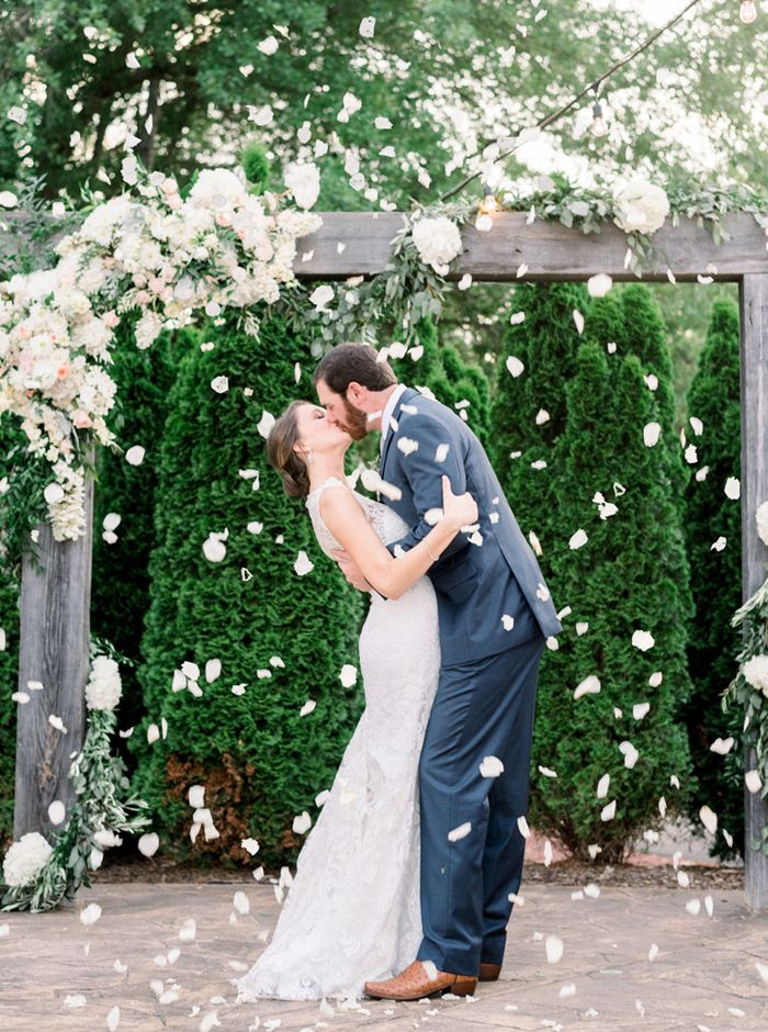Bride And Groom Kiss Under A Shower Of Rose Petals Eric Jamie Photography Venue Caterer Planner The Sonnet Courtyard Wedding Bella Bridesmaid Bride