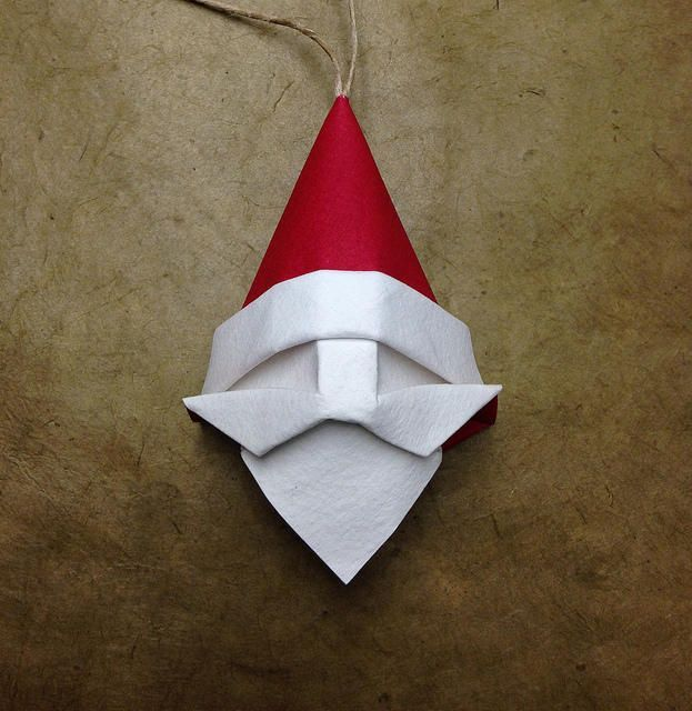 This paper craft is an Origami Santa Claus, designed by Beth Johnson. It could be a good Ornament to decorate your Christmas Tree. The Crease Pattern is he