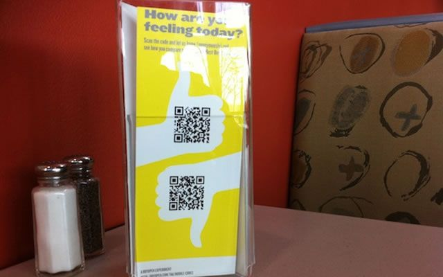 Getting customer feedback via QR codes. One code is thumbs up, the other thumbs down.