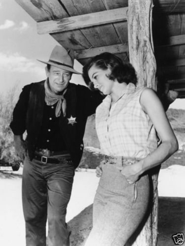 "John Wayne and Angie Dickinson on the set of director Howard Hawks' ""Rio Bravo"", 1959."
