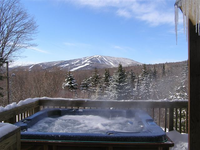 Superior Hot Tub On A Cold Day With A Recent Blanket Of Snow In The Mountains Of