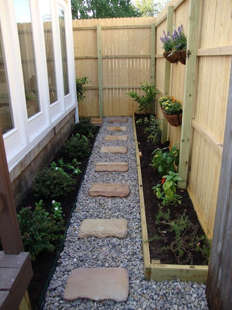 decorative gravel combined w/ stone steps to create a nice side yard - almost exactly what I was thinking in our side yard but with climbing roses to look at through the window. Now I have a visual aid. - T