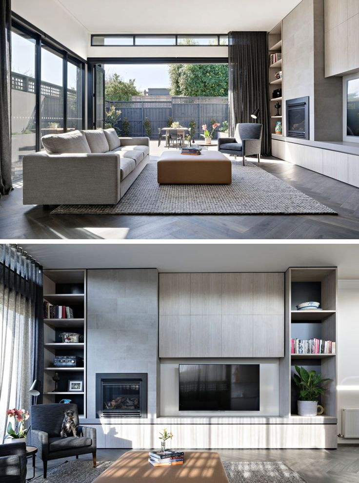 The modern living large folding glass doors leading to outside, and light wood cabinets and open shelving for storage.