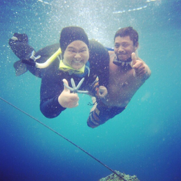 I'm with Mr.Rahim, guide from Bunaken Island. he's so nice teaching me how to snorkeling and stuff